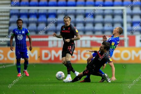 Kai Naismith (33) of Wigan Athletic is fouled by Stephen Ward (3) of Stoke City