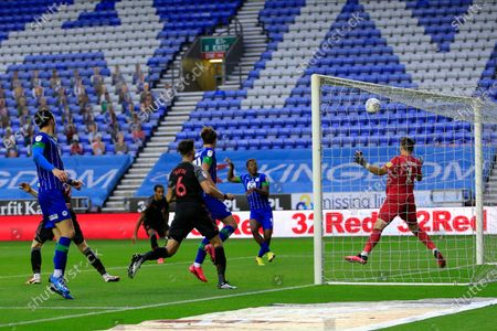 Jamal Lowe (9) of Wigan Athletic misses a great chance to make it 2-0