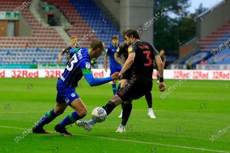 Kai Naismith (33) of Wigan Athletic beats Stephen Ward (3) of Stoke City