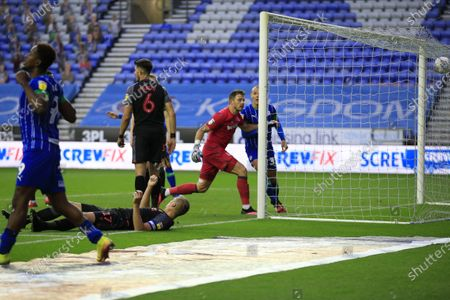 Kai Naismith (33) of Wigan Athletic prods the ball into the net o make it 2-0 to Wigan in the 65th minute