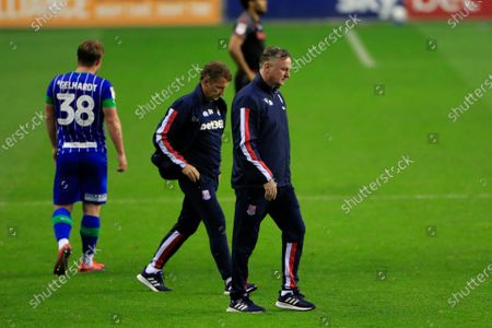A disappointed Stoke City manager Michael O'Neill walks off the field at the end of his teams 3-0 defeat to Wigan