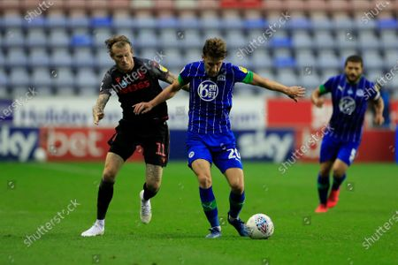 Joe Williams (20) of Wigan Athletic and James McClean (11) of Stoke City challenge for the ball