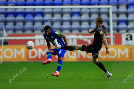 Nathan Byrne (2) of Wigan Athletic passes the ball beyond James McClean (11) of Stoke City