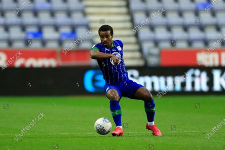 Nathan Byrne (2) of Wigan Athletic runs with the ball