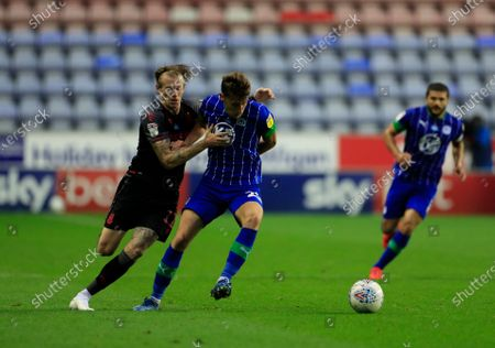 Joe Williams (20) of Wigan Athletic shields the ball from James McClean (11) of Stoke City