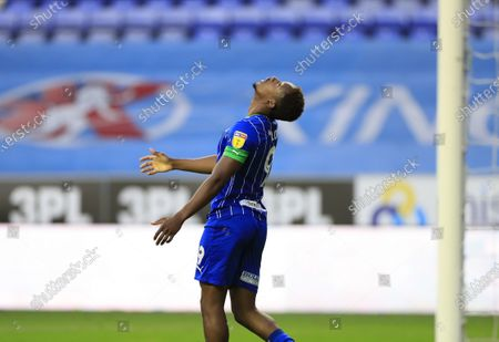 Jamal Lowe (9) of Wigan Athletic looks to the sky after missing a goal chance
