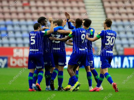Stock Photo of Wigan players congratulate Kai Naismith (33) of Wigan Athletic after scoring to make it 3-0 to Wigan in the 68th minute