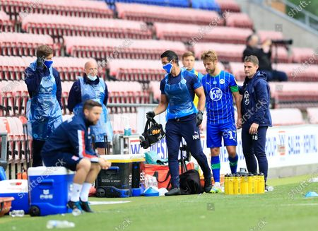 Michael Jacobs (17) of Wigan Athletic goes off injured in the first half