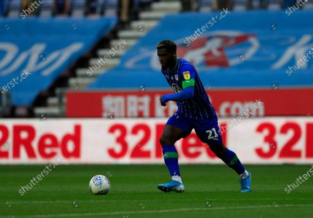 Cedric Kipre (21) of Wigan Athletic runs with the ball