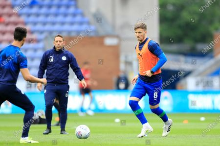 Lee Evans (8) of Wigan Athletic warms up for the game