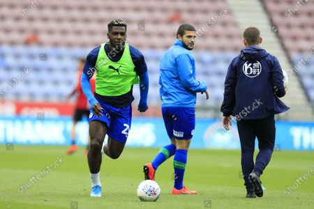 Cedric Kipre (21) of Wigan Athletic warms up for the game