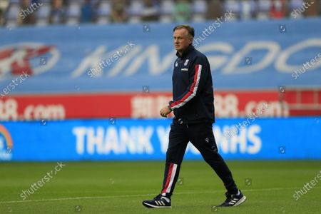 Stoke City manager Michael O'Neill walks to his place in the dug out