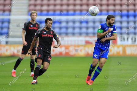 Jordan Cousins (24) of Stoke City chips the ball forward