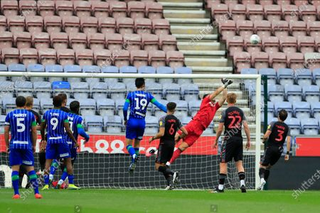 Jack Butland (1) of Stoke City makes a diving save from a Wigan free kick