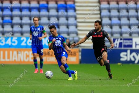 Antonee Robinson (3) of Wigan Athletic turns away from Jordan Cousins (24) of Stoke City