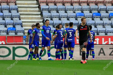 Kieran Dowell (30) of Wigan Athletic celebrates scoring in the 41st minute to make it 1-0 to Wigan