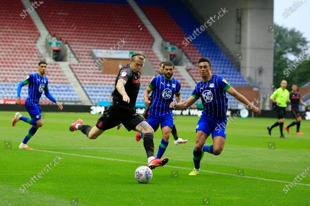 James McClean (11) of Stoke City tries to cross the ball watched by Antonee Robinson (3) of Wigan Athletic