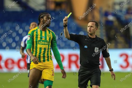 Romaine Sawyers (19) of West Bromwich Albion receives a yellow card from referee David Webb