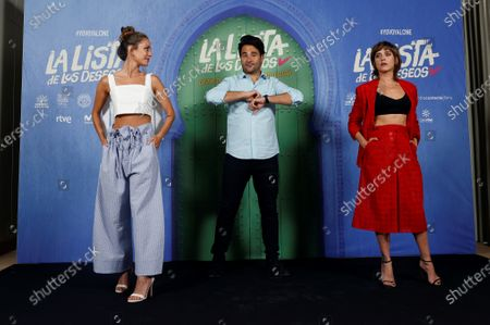 Stock Photo of Spanish film director Alvaro Diaz Lorenzo (C) greets actresses and cast members Maria Leon (R) and Silvia Alonso with the elbows as they pose for the photographers during the presentation of film 'La lista de los deseos' (lit. The Wishes' List) at a hotel in Madrid, Spain, 30 June 2020. The film opens in Spanish cinemas on 03 July.