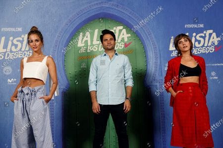 Stock Image of Spanish film director Alvaro Diaz Lorenzo (C) and cast members Maria Leon (R) and Silvia Alonso pose for the photographers during the presentation of film 'La lista de los deseos' (lit. The Wishes' List) at a hotel in Madrid, Spain, 30 June 2020. The film opens in Spanish cinemas on 03 July.