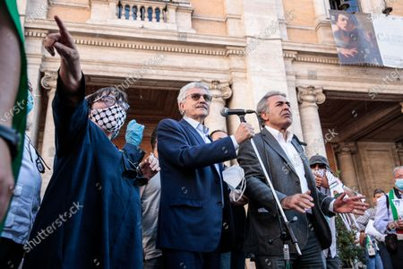 Massimo D'Alema (L) and Yousef Salman, President of Palestinian community in Rome during the protest against Israel's plan to annex parts of the occupied West Bank
