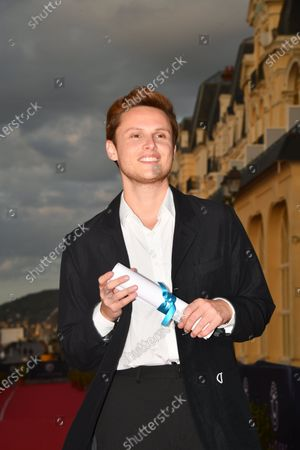 "Stock Image of Alexandre Wetter awarded ""Premiers Rendez Vous"" for an Actor poses during the Closing Ceremony"