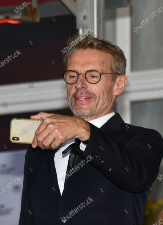 Lambert Wilson awarded Best Actor poses with their Award during the Closing Ceremony