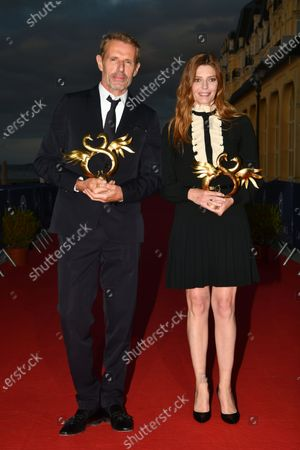 Lambert Wilson awarded Best Actor and Chiara Mastroianni awarded Best Actress pose with their Award during the Closing Ceremony