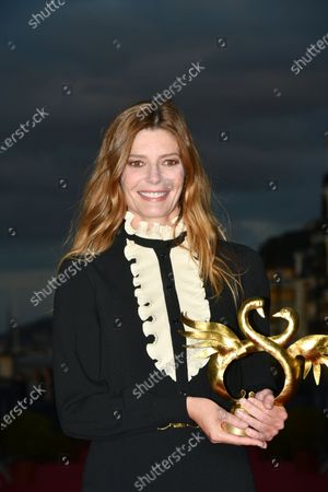 Chiara Mastroianni poses with her Award for Best Actress during the Closing Ceremony