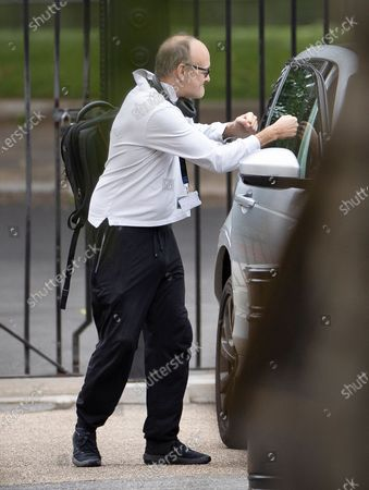 Senior government advisor Dominic Cummings jokingly punches the windows of his car as he arrives in Downing Street. Cabinet Secretary Sir Mark Sedwill has announced that he will stand down in September.