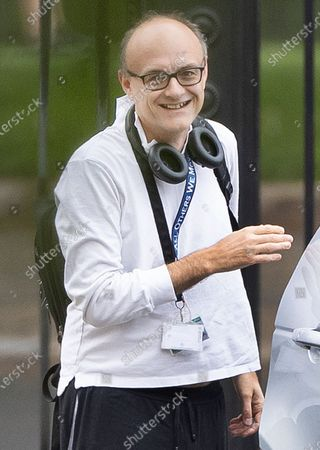 Senior government advisor Dominic Cummings smiles as he arrives in Downing Street. Cabinet Secretary Sir Mark Sedwill has announced that he will stand down in September.