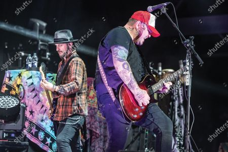 Guitarist Chris Robertson (R) and bassist John Lawhon of American rock group Black Stone Cherry performing live on stage during Ramblin' Man Fair music festival at Mote Park in Maidstone, England