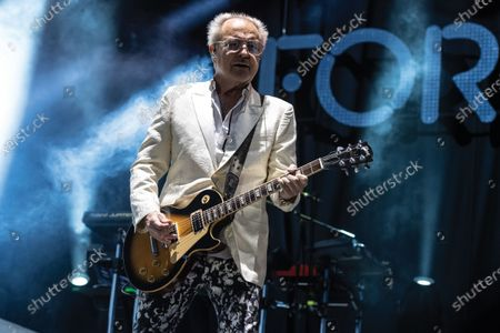 Guitarist Mick Jones of rock group Foreigner performing live on stage during Ramblin' Man Fair music festival at Mote Park in Maidstone, England
