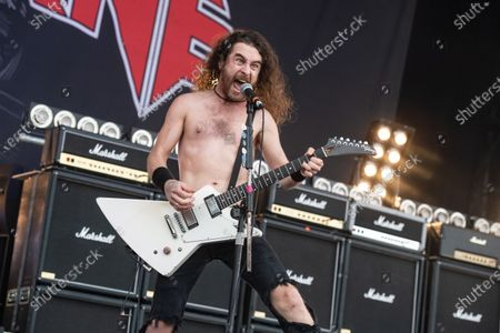 Guitarist and vocalist Joel O'Keeffe of Australian hard rock group Airbourne performing live on stage during Ramblin' Man Fair at Mote Park in Maidstone, England
