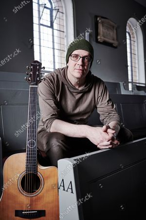 Portrait of Canadian rock musician Devin Townsend, photographed before a live performance at St George's Church in Bristol, England
