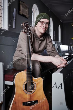 Stock Photo of Portrait of Canadian rock musician Devin Townsend, photographed before a live performance at St George's Church in Bristol, England