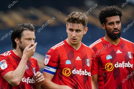 Harry Arter, Tom Cairney and Cyrus Christie of Fulham lining up