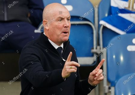Mark Warburton Manager of QPR signals on the sideline