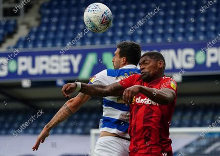 Ivan Cavaleiro of Fulham and Yoann Barbet of QPR battle for the ball