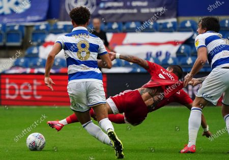 Jordan Hugill of QPR pulls the shirt of Anthony Knockaert of Fulham