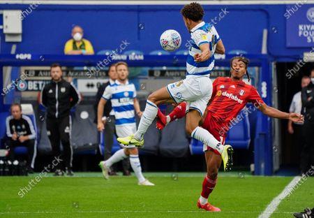 Bobby Decordova-Reid of Fulham challenges Luke Amos of QPR