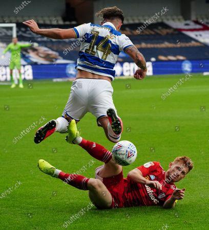 Harrison Reed of Fulham slide tackles Ryan Manning of QPR