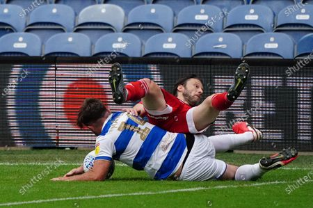 Ryan Manning of QPR fouls Harry Arter of Fulham