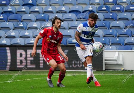 Ryan Manning of QPR plays the ball past Harry Arter of Fulham