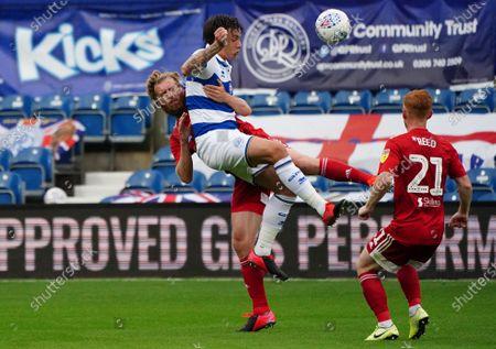 Jordan Hugill of QPR collides with Tim Ream of Fulham