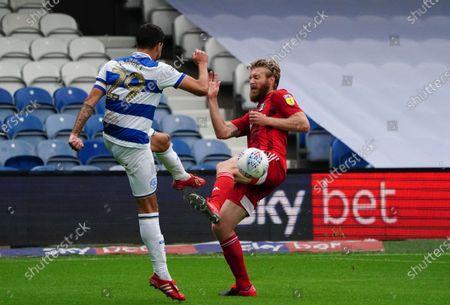 Tim Ream of Fulham blocks the strike of Yoann Barbet of QPR
