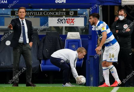 Scott Parker Manager of Fulham looks on to the pitch as Ryan Manning of QPR prepares for a throw in