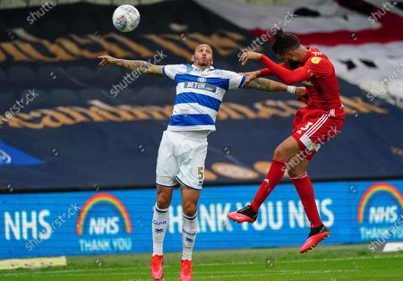 Michael Hector of Fulham wins a header over Geogg Cameron of QPR