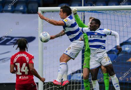 Jordan Hugill of QPR collides with Bright Osayi-Samuel of QPR and Marek Rodak of Fulham