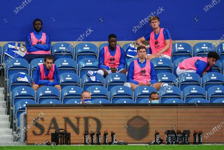 The socially distanced QPR substitutes watch the game